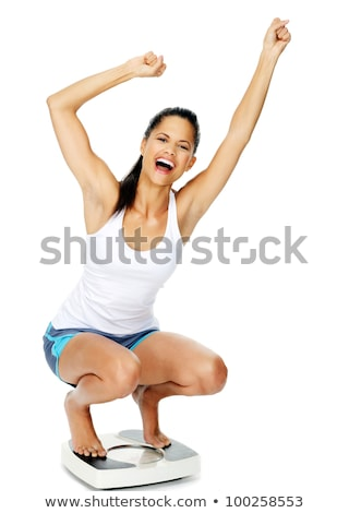 portrait of attractive woman celebrating weight loss stock photo © feedough