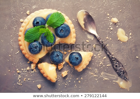 Broken tartlet with lime curd and blueberries Stock photo © Melnyk
