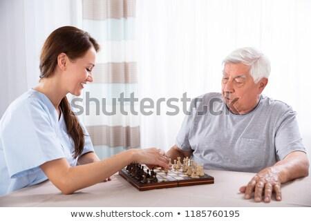 infirmière · supérieurs · maison · de · retraite · jouer · ensemble - photo stock © andreypopov