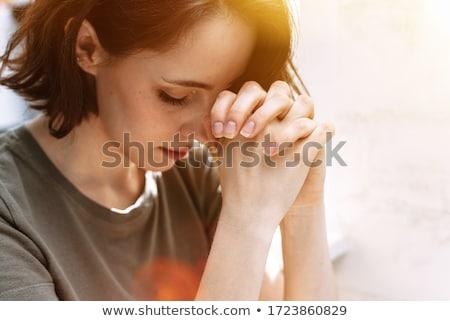 Młoda kobieta modląc boga domu kobieta domu Zdjęcia stock © AndreyPopov