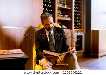 Starszy biznesmen czytania książki lobby przystojny Zdjęcia stock © boggy