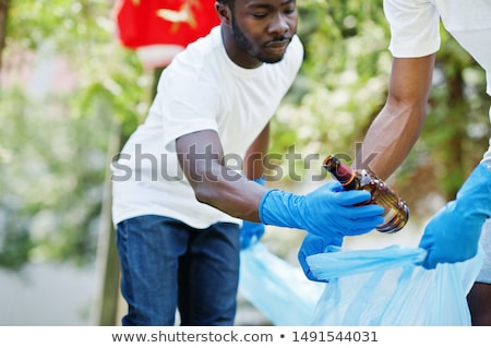 Wolontariusze śmieci torby czyszczenia parku wolontariat Zdjęcia stock © dolgachov