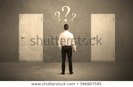 Confused businessman in front of doors Stock photo © Elnur