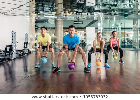 determined and strong cheerful people during functional training stock photo © kzenon
