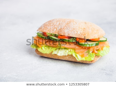 fresh healthy salmon sandwich with lettuce and cucumber on white stone background breakfast snack stock photo © denismart