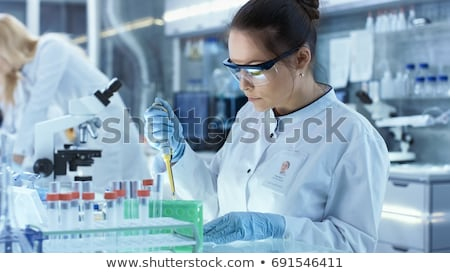 Woman scientist working with pipette in laboratory Stock photo © Kzenon