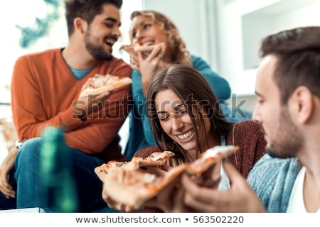 Friends eating pizza Stock photo © iko