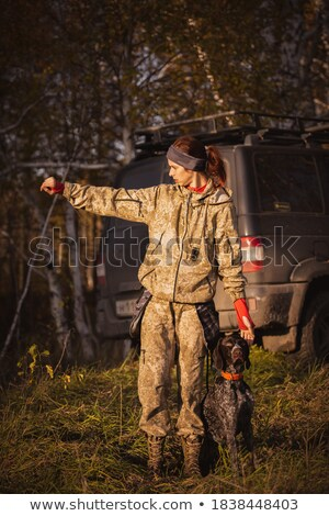 Mujer cazador bosques otono caza temporada Foto stock © lightpoet