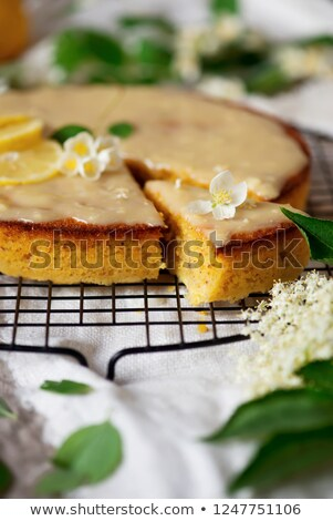 lemon polenta cake elderflower white chocolate ganache stock photo © zoryanchik