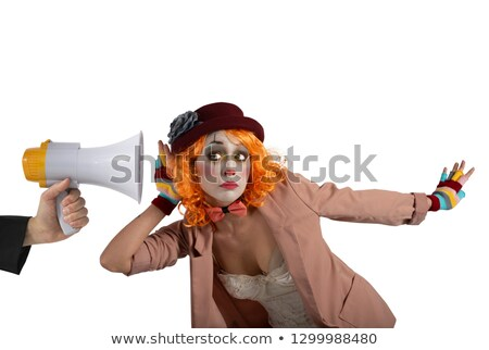 Funny clown hears a megaphone with a message. Isolated on white background Stock photo © alphaspirit