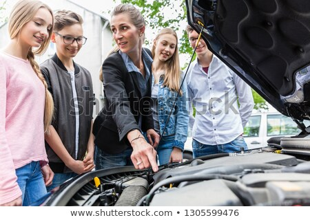 Driving teacher showing class the engine of car Stock photo © Kzenon