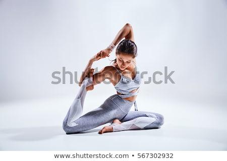 Giovani bella donna yoga posa isolato bianco Foto d'archivio © doodko
