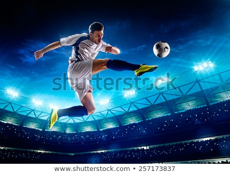 Football players in action kicking ball on stadium Stock photo © matimix