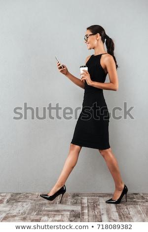 счастливым · молодые · красивая · женщина · телефон · питьевой - Сток-фото © deandrobot