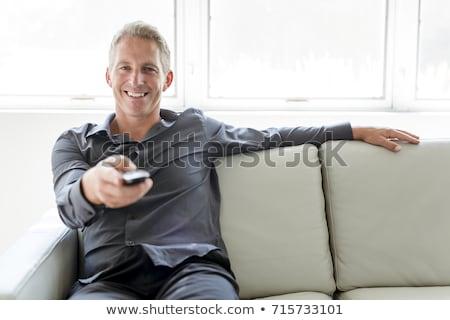 Portret 40s człowiek posiedzenia sofa Zdjęcia stock © Lopolo