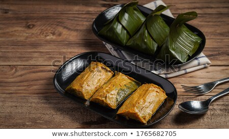 steamed fish with curry paste stock photo © koratmember
