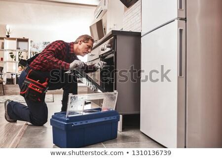 kobieta · patrząc · pracownika · piekarnik · mężczyzna - zdjęcia stock © andreypopov