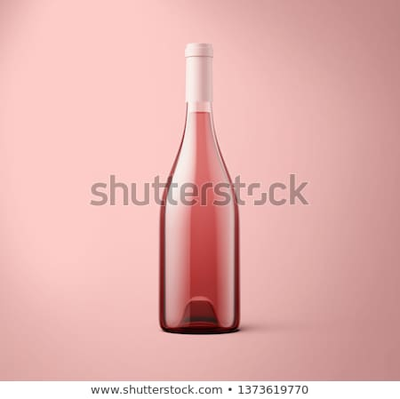 rose wine bottle and grapes stock photo © karandaev