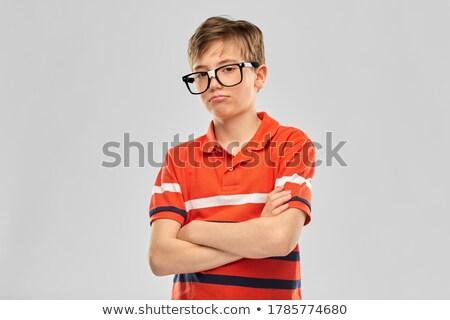 a nice unhappy pre teen boy at school stock photo © lopolo