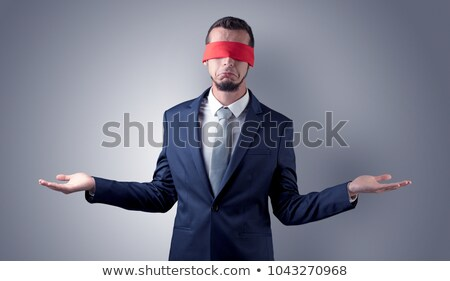 covered eye businessman in front of a wall stock photo © ra2studio