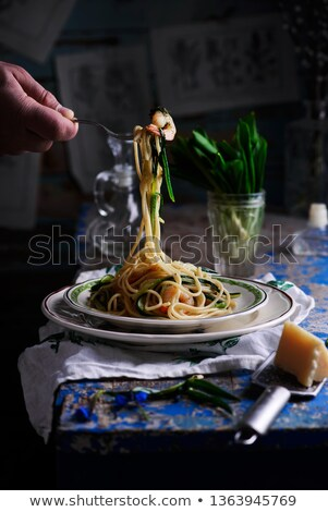 spaghetti with wild garlic and shrimps. Stock fotó © zoryanchik