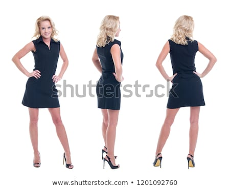 Confident blonde businesswoman stands with hands on hips Stock photo © filipw