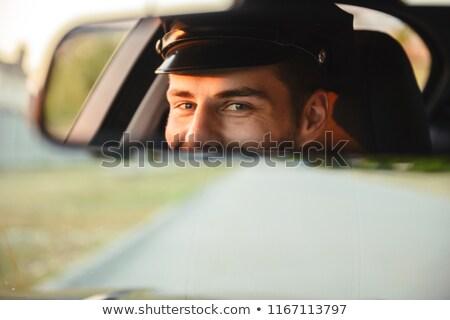 Portret jonge kaukasisch mannelijke taxi bestuurder Stockfoto © deandrobot