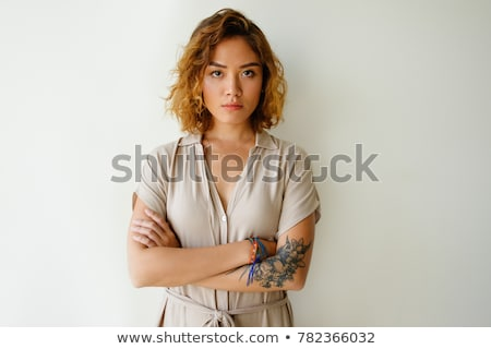 Portrait of a worried young curly blonde girl in dress Stock photo © deandrobot