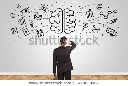 Stockfoto: Manager Looking To Wall With Overloaded Brain Concept