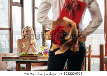man showing woman present in red box at restaurant stock photo © dolgachov