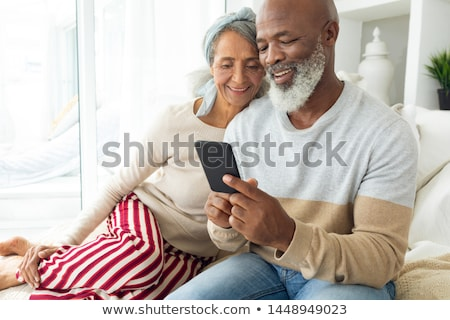 Front view of a senior couple using digital tablet in living room at home Stock photo © wavebreak_media