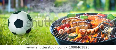 Cooking vegetables on a fire in the outdoors Stock photo © ElenaBatkova