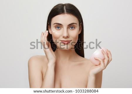 Woman posing isolated with skin cleansing cotton pad. Stock photo © deandrobot