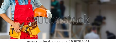 builder holding spirit level and hammer stock photo © photography33