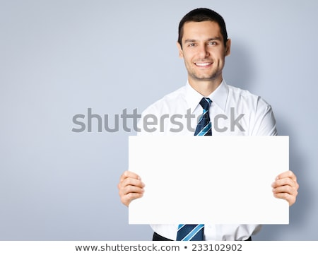 Business Man Holding Blank White Sign with Copy Space Stock photo © scheriton
