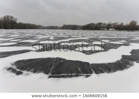 Fagyott folyó repedt jég tavasz textúra Stock fotó © IvicaNS
