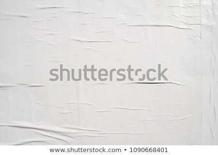 Old vintage torn creased paper isolated on black. Stock photo © latent