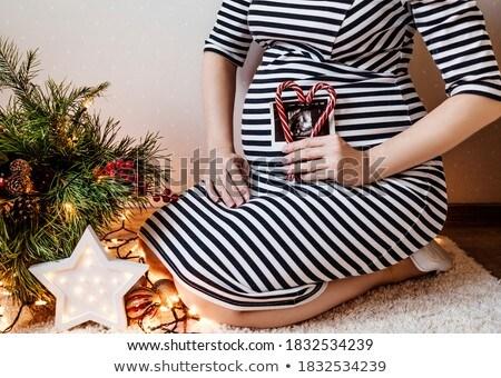 boldog · terhes · nő · piros · szív · alakú · vánkos - stock fotó © goce