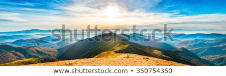 Clouds and Sun in the Mountains Stock photo © wildnerdpix