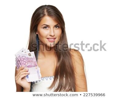 nő · tart · valuta · jegyzetek · női · igazgató - stock fotó © lunamarina