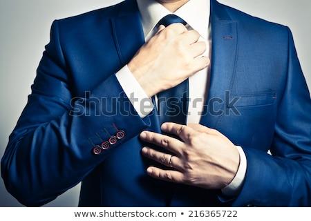 businessman adjusting tie waist up stock photo © jackethead