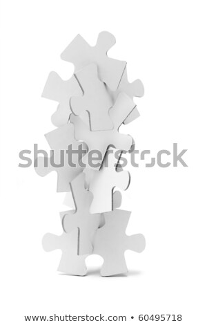 Interlocking pieces of jigsaw puzzles tower Stock photo © dezign56