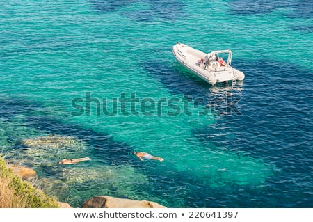Tourist swimming in clear waters of Bahamas Stock photo © epstock
