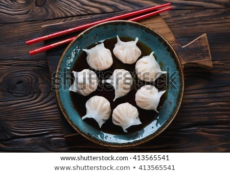 Chinese har gao dim sum dumplings on wooden plate Stock photo © nalinratphi