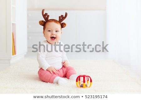 portrait of toddler with a toy stock photo © phbcz