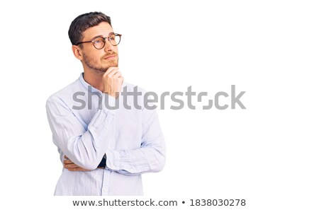 Pensive man in shirt looking up Stock photo © deandrobot