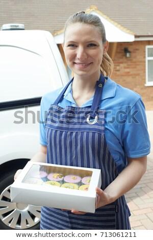 Függőleges kép mosolyog női pék tart Stock fotó © deandrobot