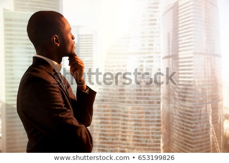 side view of a thoughtful young business man stock photo © feedough