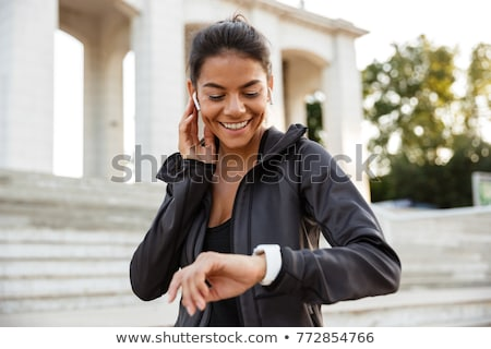 sportswoman using smartwatch Stock photo © LightFieldStudios