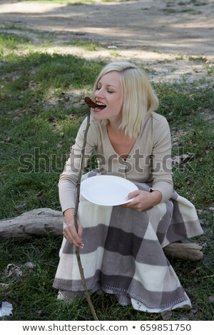 Woman at campsite eating a hotdog Stock photo © IS2